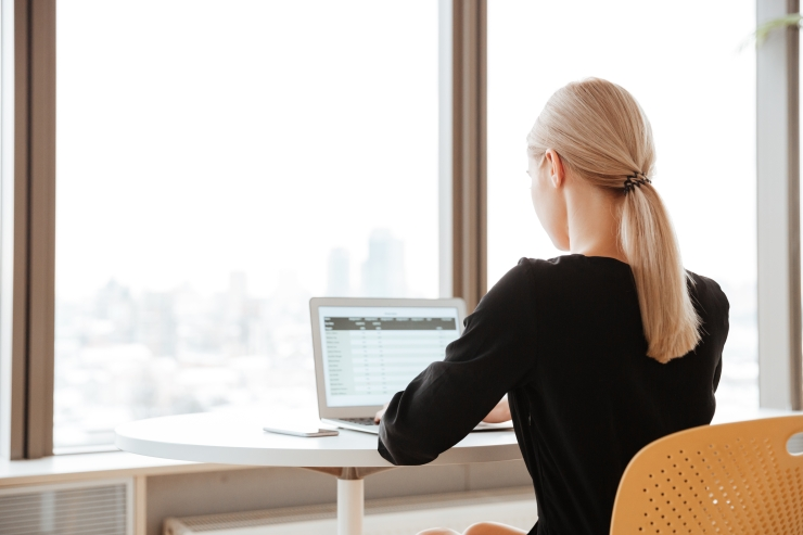 back-view-photo-of-young-woman-worker-sitting-in-office-My Virtual Services.jpg
